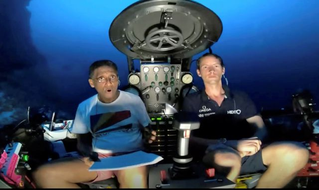 An image taken from video issued by Nekton shows Seychelles President Danny Faure, left, speaking from inside a submersible from the vessel Ocean Zephyr, under the water off the coast of Desroches, in the outer islands of Seychelles Sunday April 14, 2019. Faure toured the vessel and was presented with some of the findings and observations made by a British-led science expedition documenting changes taking place beneath the waves that could affect billions of people in the surrounding...