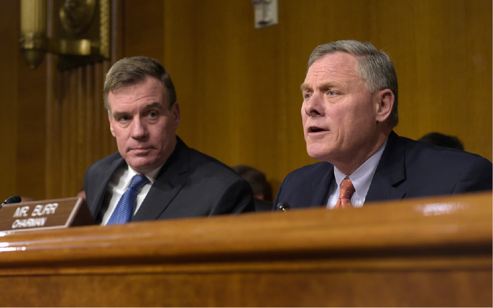 Senate Intelligence Committee Chairman. Sen. Richard Burr, R-N.C., right, joined by Vice Chairman Sen. Mark Warner, D-Va., left, speaks at the Senate Intelligence Committee hearing on Capitol Hill in Washington, Thursday, March 30, 2017. Lawmakers heading the Senate intelligence committee focused squarely on Russia as they opened a hearing Thursday on attempts at undermining the 2016 U.S. presidential election. (AP Photo/Susan Walsh)