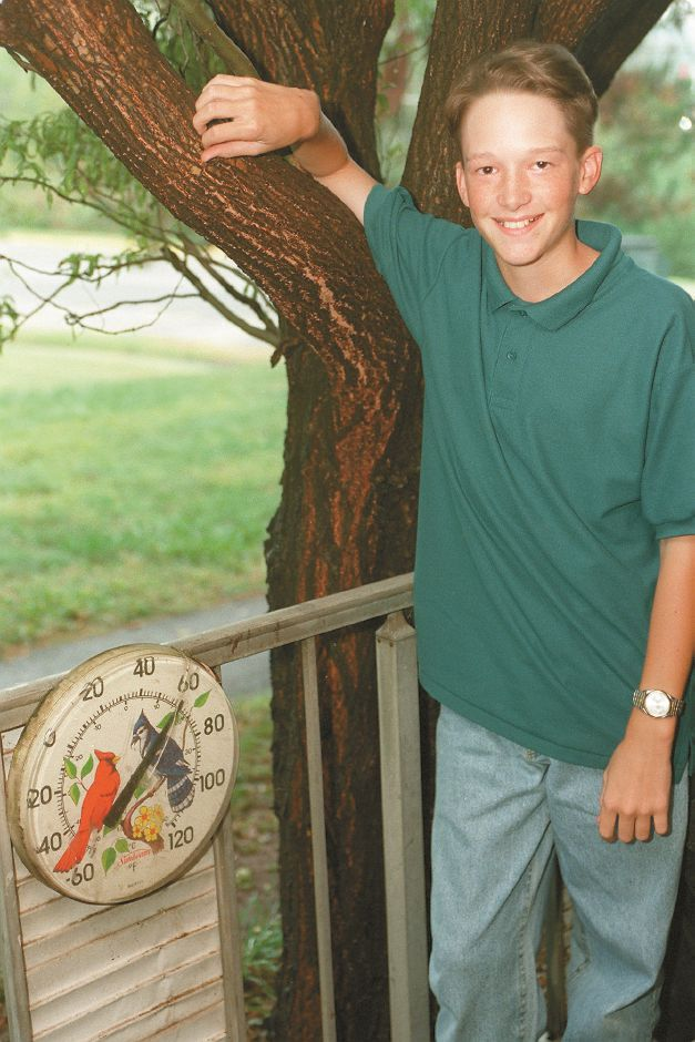 RJ file photo - Bryan Soltis, 13, a student at DePaolo Middle School in Southongton on the porch of his Southington home. The eighth-grader conducted a study of local weather forecasts over the summer to determine who was the most accurate. WTIC Fox 61 emerged as victorious, Sept. 1998.