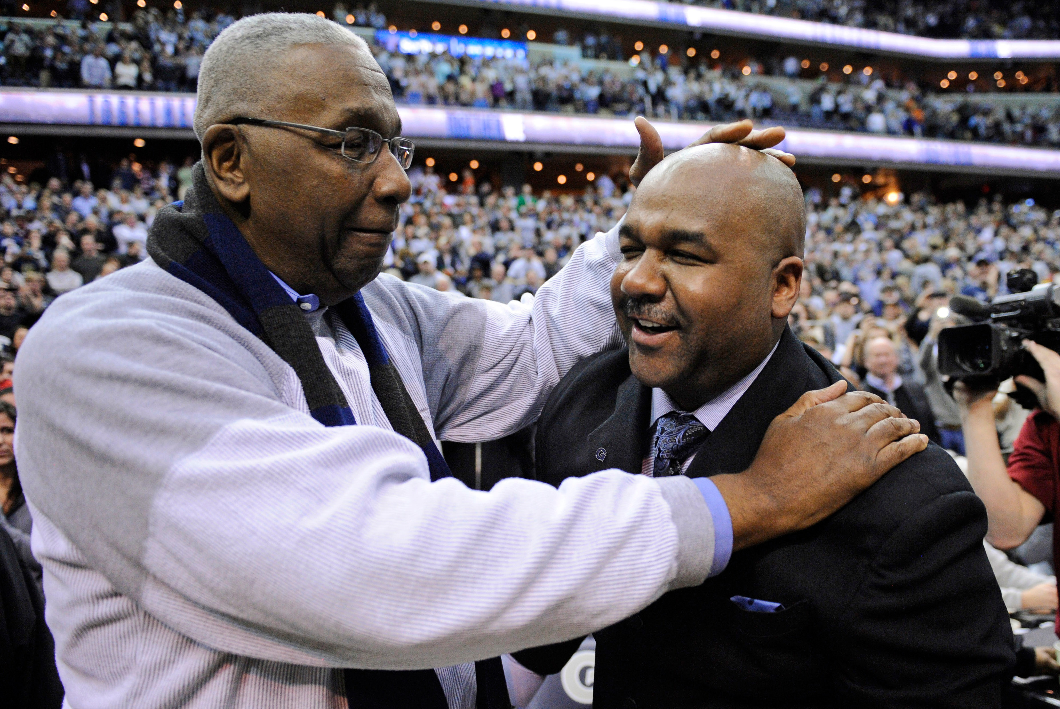 FILE - In this March 9, 2013, file photo, former Georgetown coach John Thompson Jr., left, congratulates his son Georgetown head coach John Thompson III, right, after the Hoya