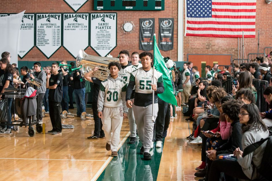 The football team enters the gym as the marching band plays Friday during a pep rally for the Maloney football team at Maloney High School in Meriden December 7, 2018 | Justin Weekes / Special to the Record-Journal
