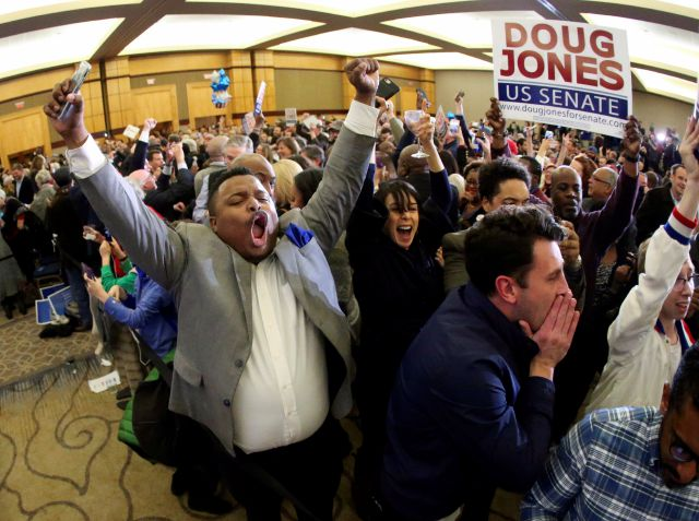 Supporters of Doug Jones erupt is celebration during an election-night watch party Tuesday, Dec. 12, 2017, in Birmingham, Ala. In a stunning victory aided by scandal, Democrat Doug Jones won Alabama