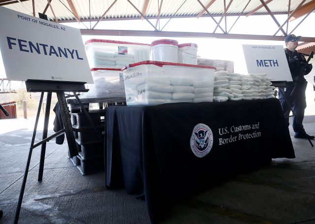 A display of the fentanyl and meth that was seized by Customs and Border Protection officers over the weekend at the Nogales Port of Entry is shown during a press conference on Thursday, Jan. 31, 2019, in Nogales, Ariz.  U.S. Customs and Border Protection officials announced Thursday their biggest fentanyl bust ever, saying they captured nearly 254 pounds (114 kilograms) of the deadly synthetic opioid from a secret compartment inside a load of Mexican produce heading into Arizona.  (Mamta Popat/Arizona Daily Star via AP)