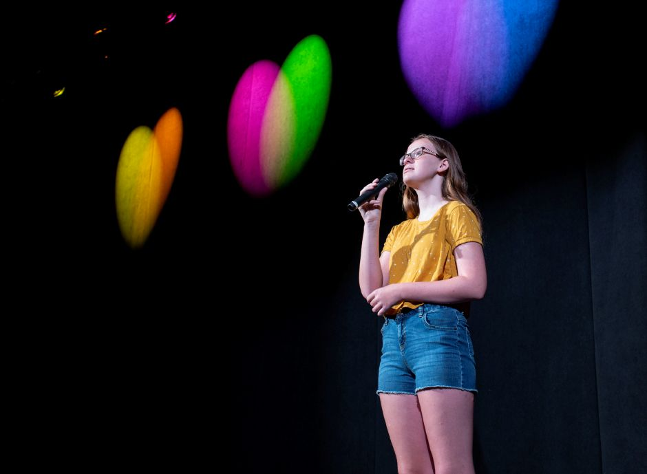 Megan Connors, 12, takes the stage for a solo during a rehearsal with the Junior Performance Academy at Sheehan High School in Wallingford July 10, 2019. | Richie Rathsack, Record-Journal