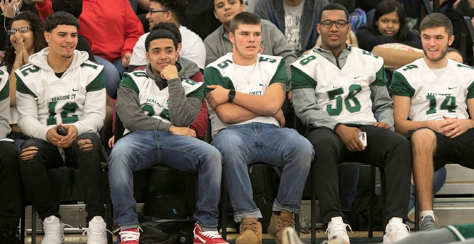 Maloney football team members watch the powder puff cheerleaders perform during the annual pep rally at Maloney High School in Meriden, Wednesday, Nov. 22, 2017. | Dave Zajac, Record-Journal