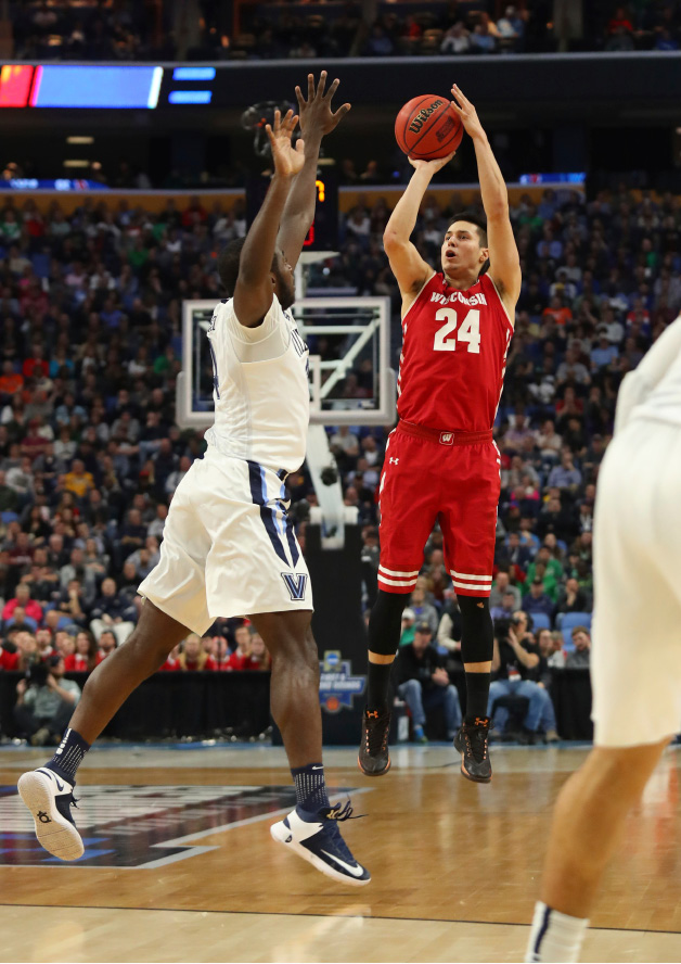 Wisconsin guard Bronson Koenig (24) shoots against Villanova forward Eric Paschall (4) during the first half of a second-round men