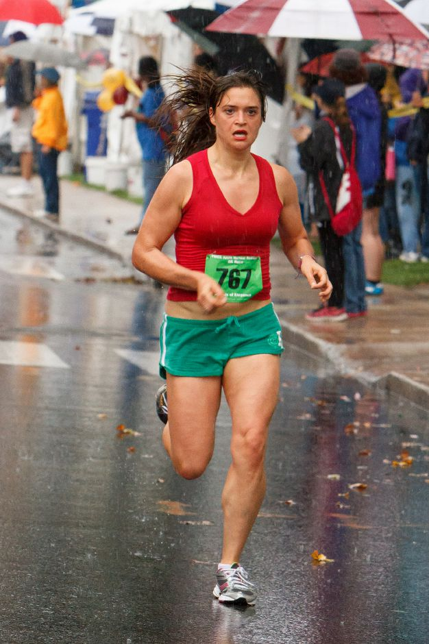 Brittany Heniger of Bridgeport was the first female 5k finisher in the Apple Harvest Road Race in Southington Sunday October,6 2013 | (Justin Weekes / For the Record-Journal)