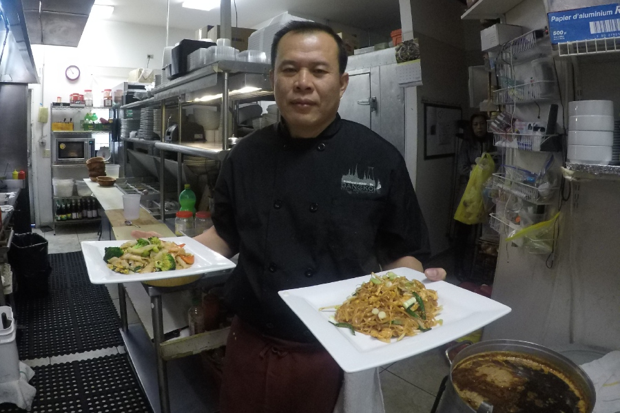 Left: Somewhere in Bangkok co-owner Song Siboriboun presents Pad Thai and Drunken Noodles, two popular dishes served at the restaurant at 1103 Queen St. in Southington. Right: Siboriboun prepares Drunken Noodles. For more photos, visit us online at www.myrecordjournal.com. Photos by Ashley Kus, Record-Journal