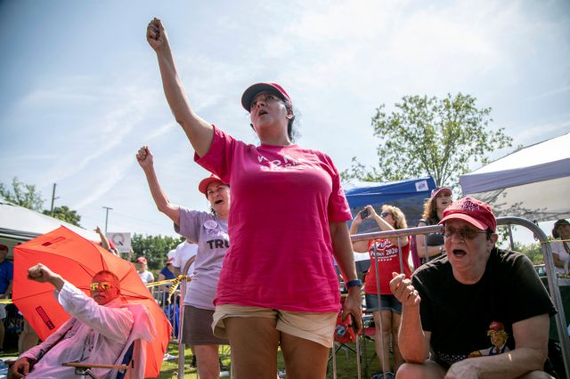 "From left, Maureen Fuster, Rosealinda Dorris and Carole Greenberg chant ""Trump"" while waiting in line to see President Donald Trump, Wednesday morning, July 17, 2019 prior to a campaign rally at East Carolina University in Greenville, NC.(Travis Long/The News & Observer via AP)"
