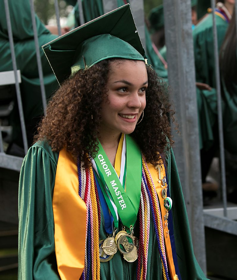 Choir Master, Mia Atterberry, waits for her name to be called for her diploma during graduation ceremonies at Maloney High School in Meriden, Tuesday, June 13, 2017. | Dave Zajac, Record-Journal