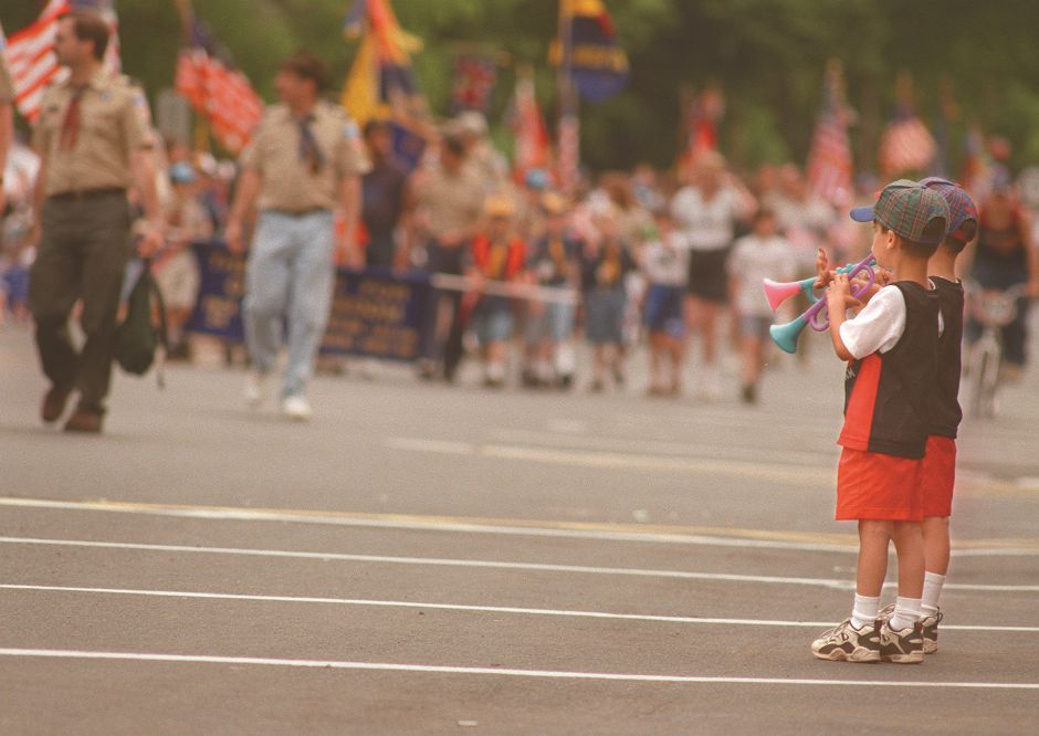 RJ file photo - Twin brothers, Andrew and Christopher Massimino, join Wallingford Memorial Day parade marchers by blowing their horns, May 1998.