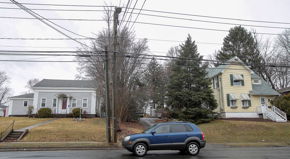 A motorist travels past 19th-century homes at 60 Broad Street, left, and 66 Broad Street, right, in Meriden, Fri., Mar. 22, 2019. A Harwinton developer won Planning Commission approval last week to build a 9,1000 square foot retail building at 60 and 66 Broad St. Dave Zajac, Record-Journal