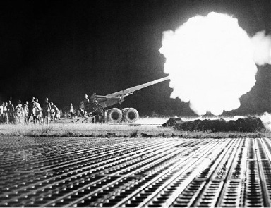 "Indochina, September 1, 1953  A command raid callled operation ""Claude"" took place in the Tien-lang district of Indochina . Seen a 155mm gun firing in the night along a road. (AP Photo)"