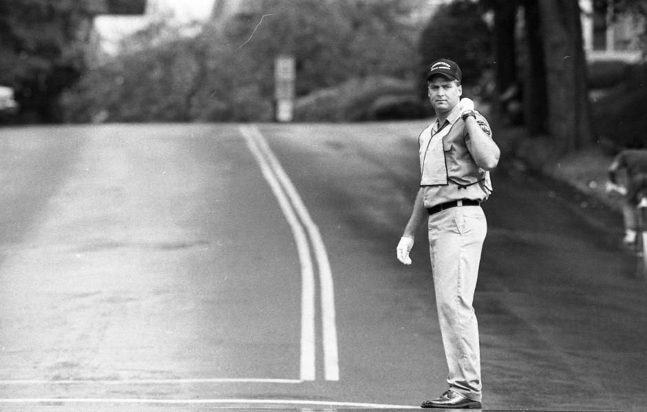 RJ file photo - State police trainee Todd Carlson practices traffic control at the intersection of Liberty and Broad streets July 14, 1989.