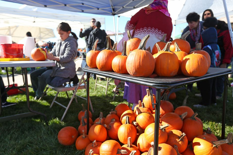 Children paint pumpkins and play Halloween games on the Meriden Green during the last farmer's market of the season on Saturday, Oct. 20, 2019. Emily J. Tilley, special to the Record-Journal.