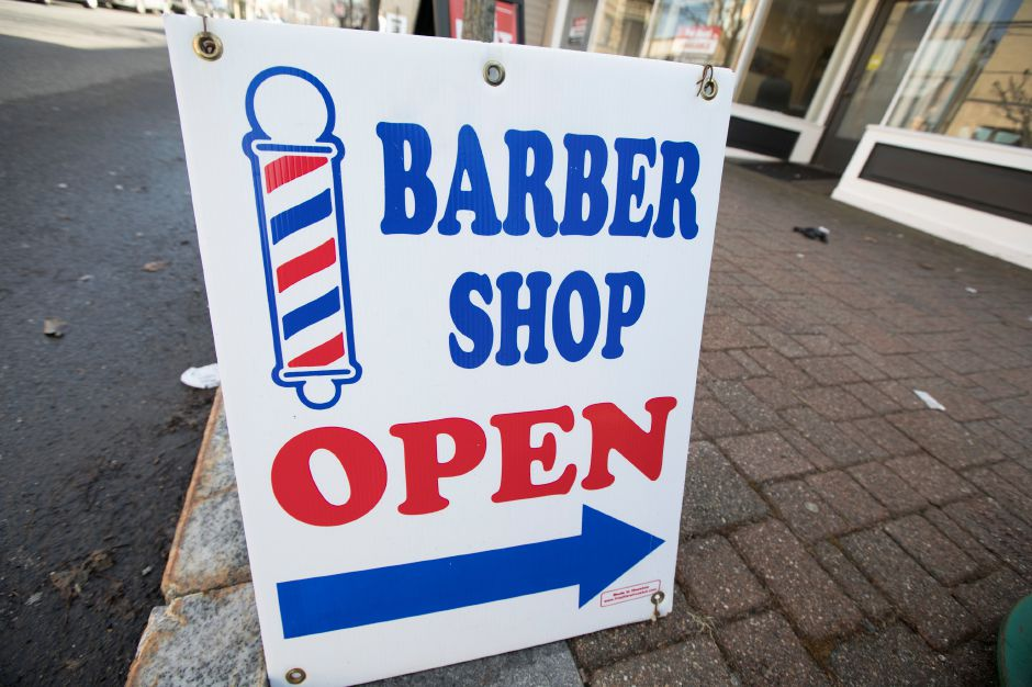 A sign for Trey's Barbershop on Center Street in Southington, Wednesday morning, February 21, 2018. Dave Zajac, Record-Journal