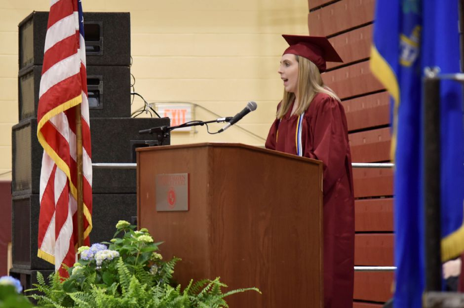 Kathleen Mountcastle addresses fellow graduates during the North Haven High School graduation ceremonies indoors at the school on June 13, 2019. | Bailey Wright, Record-Journal