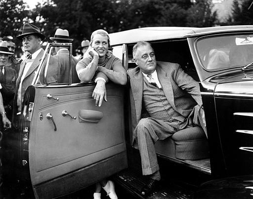 "President Franklin Delano Roosevelt relaxes in a motorcade car accompanied by his daughter, Anna Boettiger, during a baseball game between White House newspapermen and a team fielded by broadcast journalist Lowell Thomas at Quaker Hill near Pawling, N.Y., Sept. 21, 1935. The ""White House Sinner"