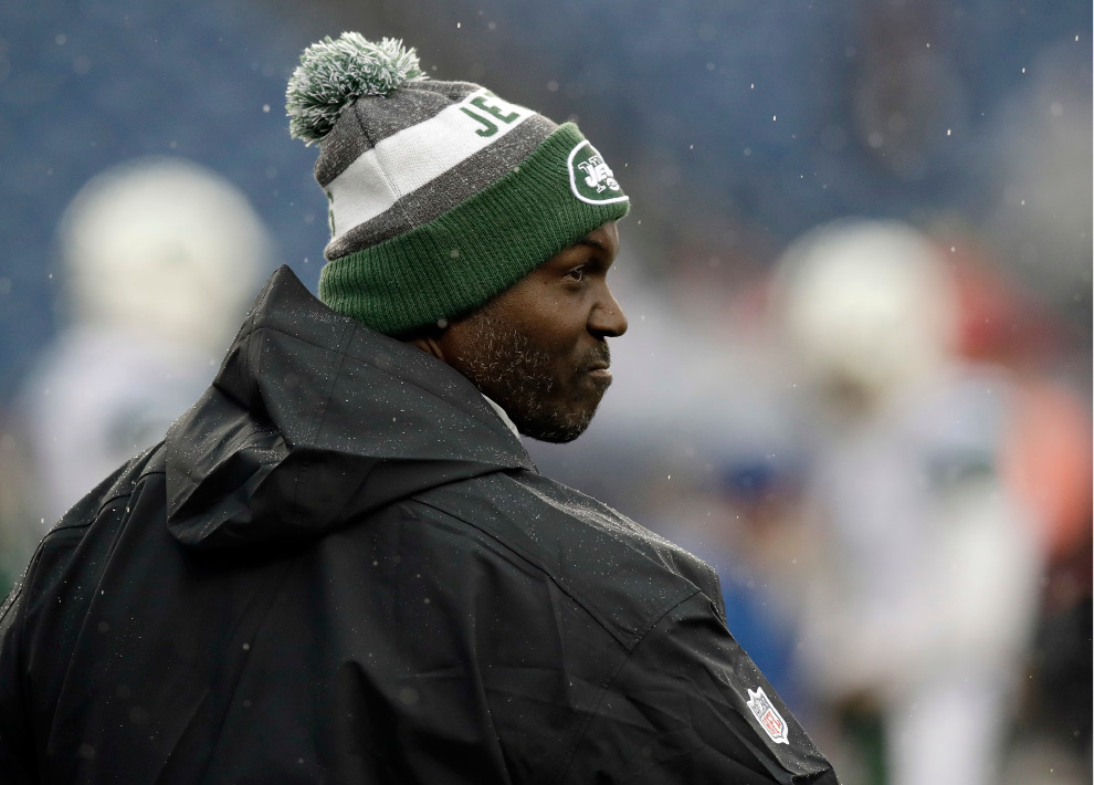 New York Jets head coach Todd Bowles watches his team warm up before an NFL football game against the New England Patriots, Saturday, Dec. 24, 2016, in Foxborough, Mass. (AP Photo/Charles Krupa)