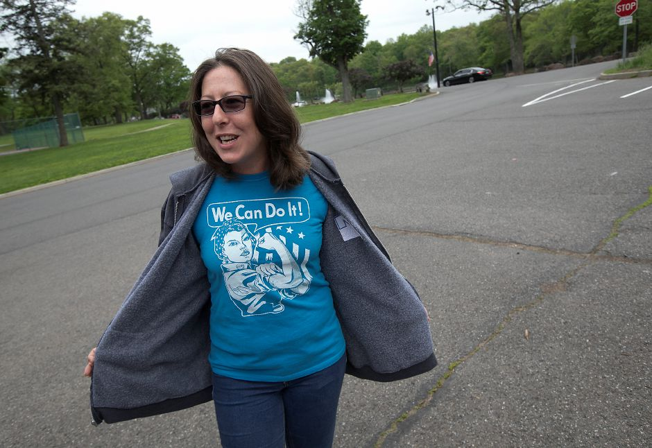 "Sharon Milano, of Meriden, sports a ""We Can Do It"" T-shirt while helping collect signatures for a petition against the city budget at Hubbard Park in Meriden, Tuesday, May 22, 2018. The City Council adopted a $198.1-million spending plan for the upcoming 2018-19 fiscal year. 