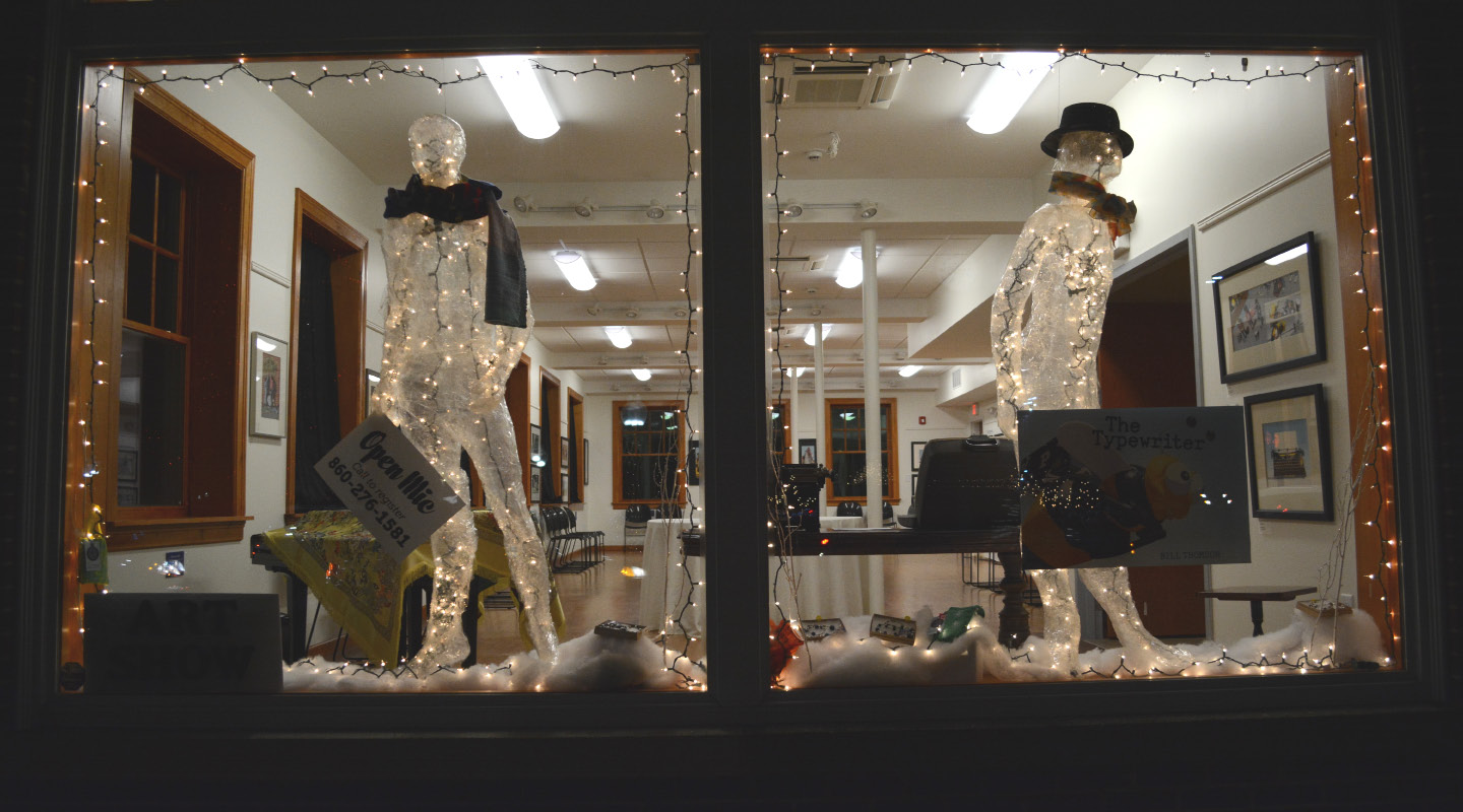 Tape figures in windows at the Southington Community Cultural Arts building.| Bryan Lipiner, Record-Journal