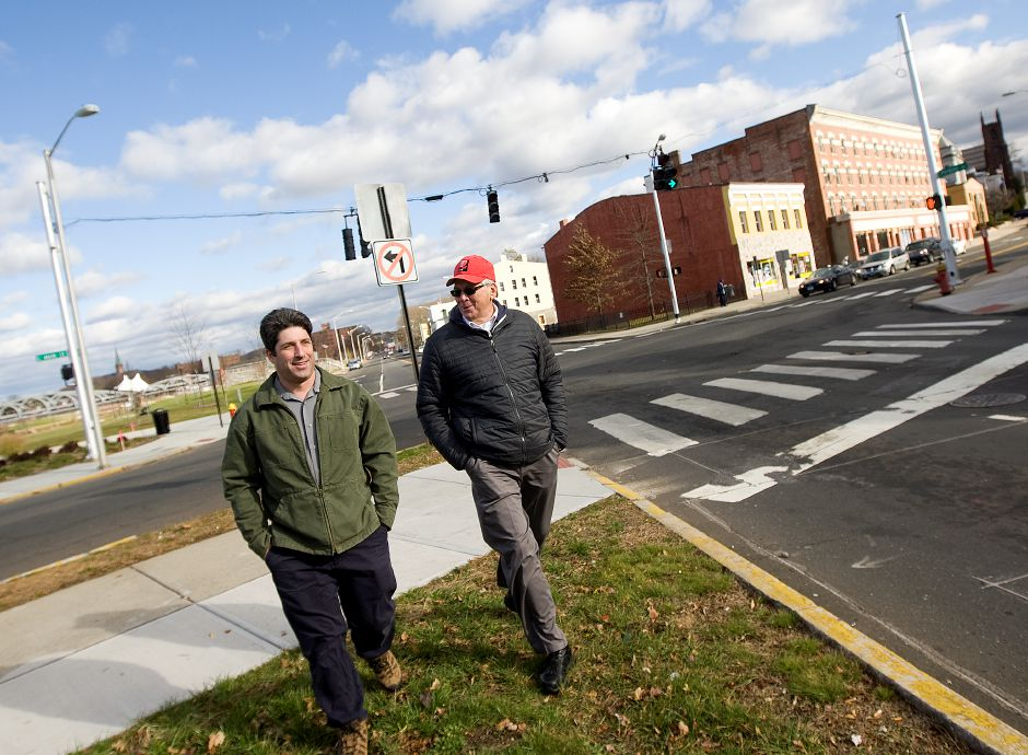 Associate City Engineer Howard Weissberg, left, and Public Works Director Robert Bass walk along Perkins Street near East Main Street in downtown Meriden, Friday, December 2, 2016. | Dave Zajac, Record-Journal