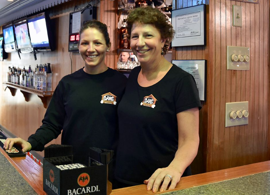 Owners Bianca Jacques, left, and her mother, Louise, of Berlin, pose Thursday at the new Dawg House Bar & Grill at 999 Broad St. in Meriden. Bailey Wright, Record-Journal