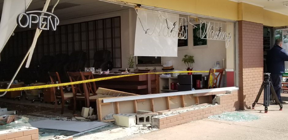 A car crashed into a nail salon on East Center Street Thursday morning. | Jeniece Roman, Record-Journal