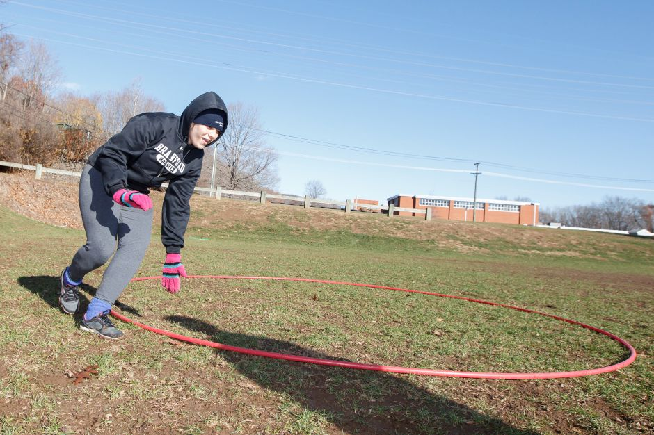 Elisa Vazquez 17 runs the figure eight agility drill Saturday during Powder Puff practice at Wilcox Tech in Meriden Nov 15, 2014 | Justin Weekes / For the Record-Journal