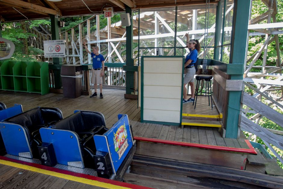 Lake Compounce staff give an all clear sign to start a test run of Boulder Dash ahead of the park opening for the day Aug. 8, 2018. | Richie Rathsack, Record-Journal
