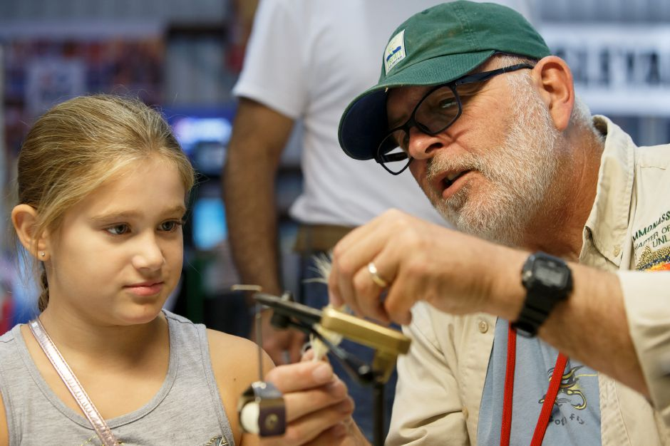 Rick Huntly show Kyla Sinski 11 of North Branford how to tie a fly lure Saturday during the 99th Durham Fair on the Durham Fairgrounds in Durham September 29, 2018 | Justin Weekes / Special to the Record-Journal