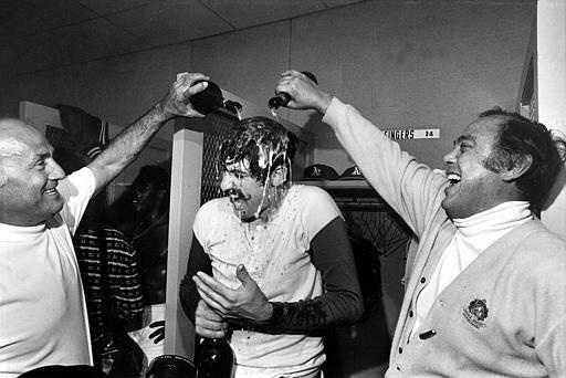 Oakland Athetics relief pitcher Rollie Fingers gets drenched in champagne during victory celebrations in the dressing room after winning the World Series in Cincinnati, Ohio, Oct. 22, 1972. Fingers saved the A