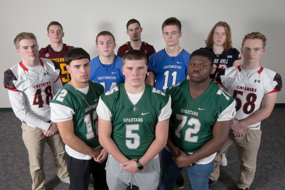 Introducing the defensive unit of the 2017 All-Record-Journal Football Team. The three Maloney players in front are, from left, Cruz Lenhart, Mitchell McEwen and Desmond King. In the middle row, from left, are Apple Classic rivals Ethan Bronson of Cheshire, Ian Hall and Sam Thomson of Southington, and Nick Nelson of Cheshire. In the back row, from left, are Carini Bowl rivals Will Terzi and Evan Mansfield of Sheehan and Zach Kizer of Lyman Hall. Missing from the photo are Lyman Hall's Randy McFarline and Maloney's O'Neal Ward. | Justin Weekes / For the Record-Journal
