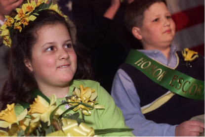 Thomas Hooker Elementary School representative Catherine Haggett,8,left, smiles after being crowned  Little Miss Daffodil for 2003 at Hubbard Park in Meriden Wednesday evening. At right is winning escort  Zachary Wedge,10, representing Nathan Hale Elementary School.