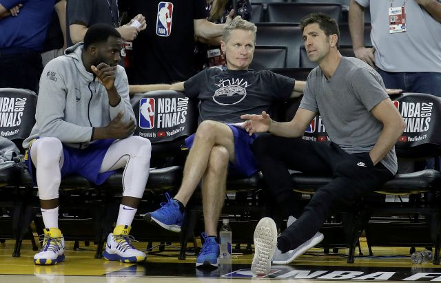 Golden State Warriors general manager Bob Myers, right, talks with forward Draymond Green, left, and head coach Steve Kerr during a team practice in Oakland, Calif., Wednesday, June 12, 2019. The Warriors are scheduled to play the Toronto Raptors in Game 6 of basketball