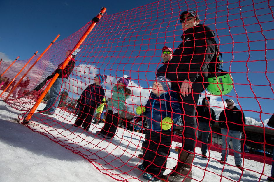 Kristen Rossi and her son Henry 1 of Westport watch from the spectator area Saturday during the East Coast Snocross race at Mount Southington Ski in Plantsville March 16, 2019 | Justin Weekes / Special to the Record-Journal