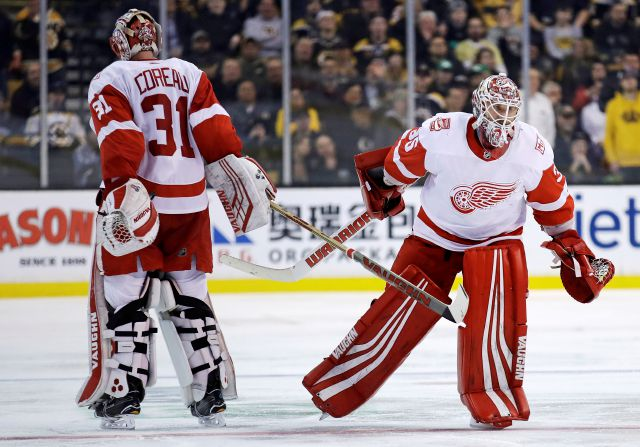 Detroit Red Wings goaltender Jimmy Howard, right, replaces goaltender Jared Coreau, who had allowed a goal by Boston Bruins left wing Brad Marchand, during the second period of an NHL hockey game in Boston, Tuesday, March 6, 2018. (AP Photo/Charles Krupa)
