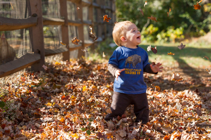 Joshua Brodeur 1 of Plainville laughs as Mom tosses leaves over his head  Sunday during the Goats and Goblins Parade at Bradley Mountain Soaps in Southington Oct. 30, 2016 | Justin Weekes / For the Record-Journal