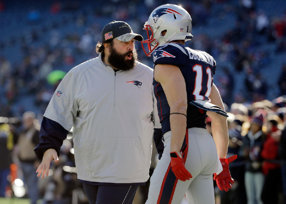 FILE - In this Dec. 4, 2016, file photo, New England Patriots defensive coordinator Matt Patricia, left, talks to wide receiver Julian Edelman (11) before an NFL football game against the Los Angeles Rams, in Foxborough, Mass. Patriots coordinators Josh McDaniels and Matt Patricia have been considered among the best minds in football for a while now. The jobs they