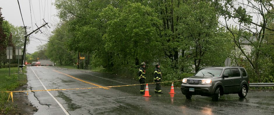 A snapped utility pole closed a portion of Miller Avenue in Meriden during Tuesday