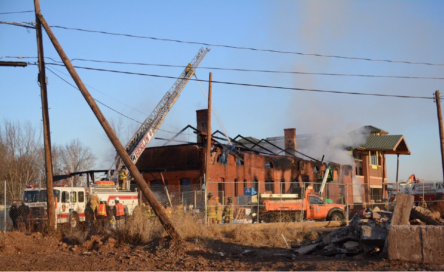 Firefighters respond to a fire at the old Berlin train station. | Bryan Lipiner, Record-Journal
