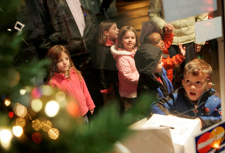 "Record Journal Photo/ Johnathon Henninger 12.04.08 - Charlie Vath, 2, looks into CMC Computers waiting in line to see Mrs. Clause at ""Christmas in the Village"" in Plantsville Thursday night."