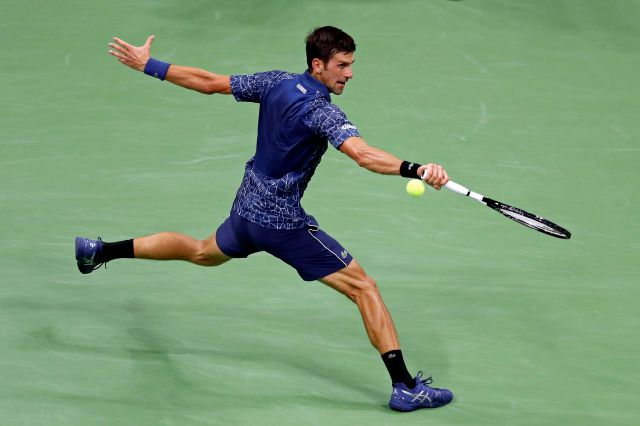 Novak Djokovic, of Serbia, reaches for a shot from John Millman, of Australia, during the quarterfinals of the U.S. Open tennis tournament Wednesday, Sept. 5, 2018, in New York. (AP Photo/Adam Hunger)