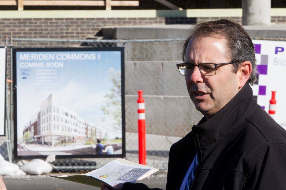 Charlie Adam of Pennrose Properties talks about Meriden Commons One Wednesday during a walking tour of Meriden