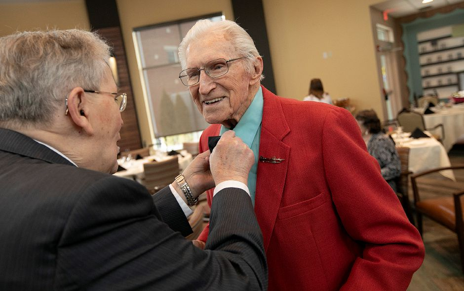 Steve Robey, left, helps fellow Elim Park resident, Al Jarus with his bow tie during the annual senior citizen prom for residents of Elim Park, Fri., Mar. 1, 2019. The prom was organized by members of the Student Nurses Association at Quinnipiac University. Dave Zajac, Record-Journal