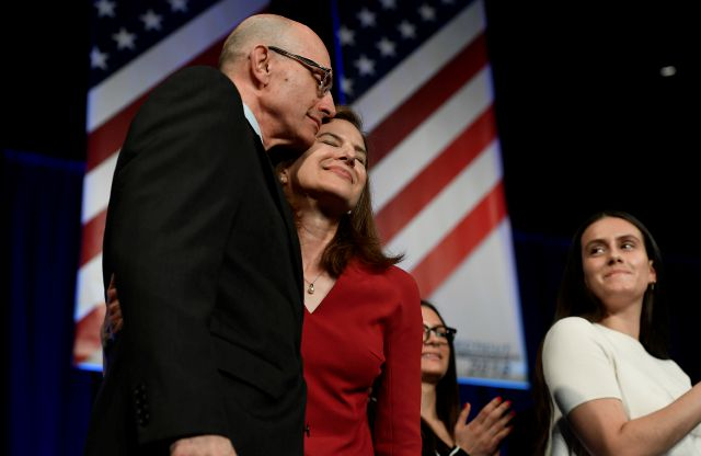 Susan Bysiewicz, endorsed candidate for Lt. Governor is embraced by her husband David Donaldson at the State Democratic Convention, Saturday, May 19, 2018, in Hartford, Conn. Connecticut Democrats are gathering for a second consecutive day to finish endorsing their slate of candidates for the November elections, including governor. (AP Photo/Jessica Hill)