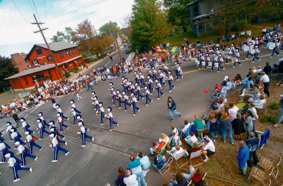 RJ file photo - The Southington High School Marching Band leads the way as the Apple Harvest Festival parade crosses the intersection of Bristol, Center and South Center streets near the start of the parade route Oct. 4, 1998.