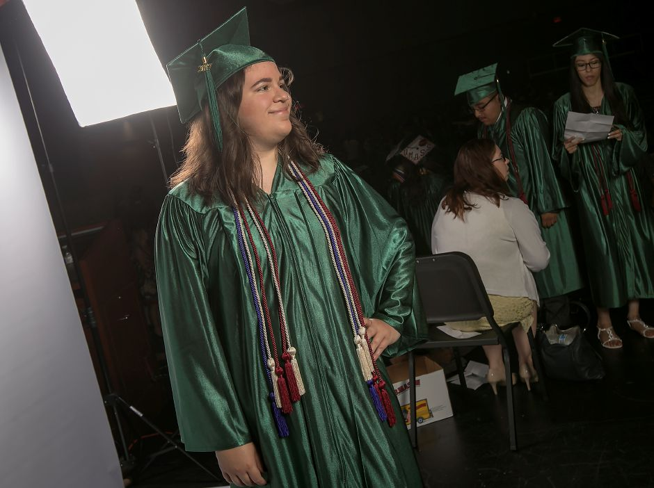 Graduate Eboni Traverso gets her picture taken before the start of graduation ceremonies at Maloney High School in Meriden, Tuesday, June 13, 2017. | Dave Zajac, Record-Journal