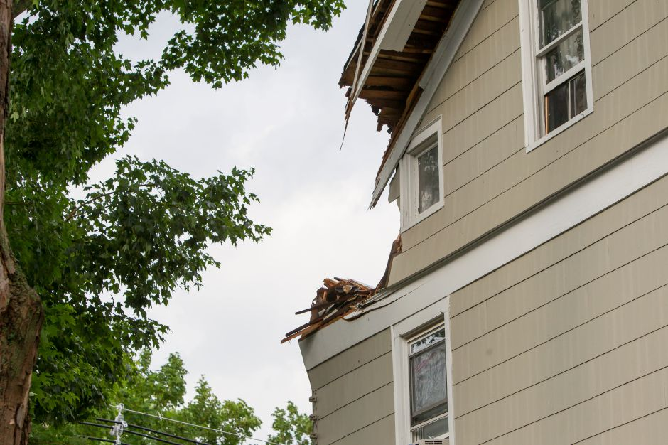 A corner of a house on Ward Street was damaged when a limb fell during a thunder storm Tuesday in Wallingford Jun. 23, 2015 | Justin Weekes / For the Record-Journal
