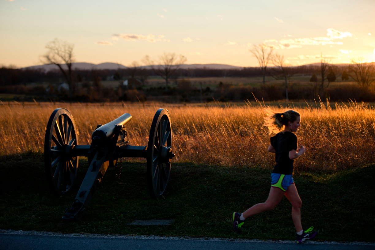 A runner passes through Gettysburg National Military Park, Monday, Nov. 18, 2013, in Gettysburg, Pa. Nov. 19th marks the 150th anniversary of President Abraham Lincoln